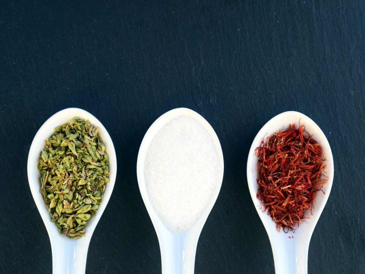 Herbs and spices on spoons.