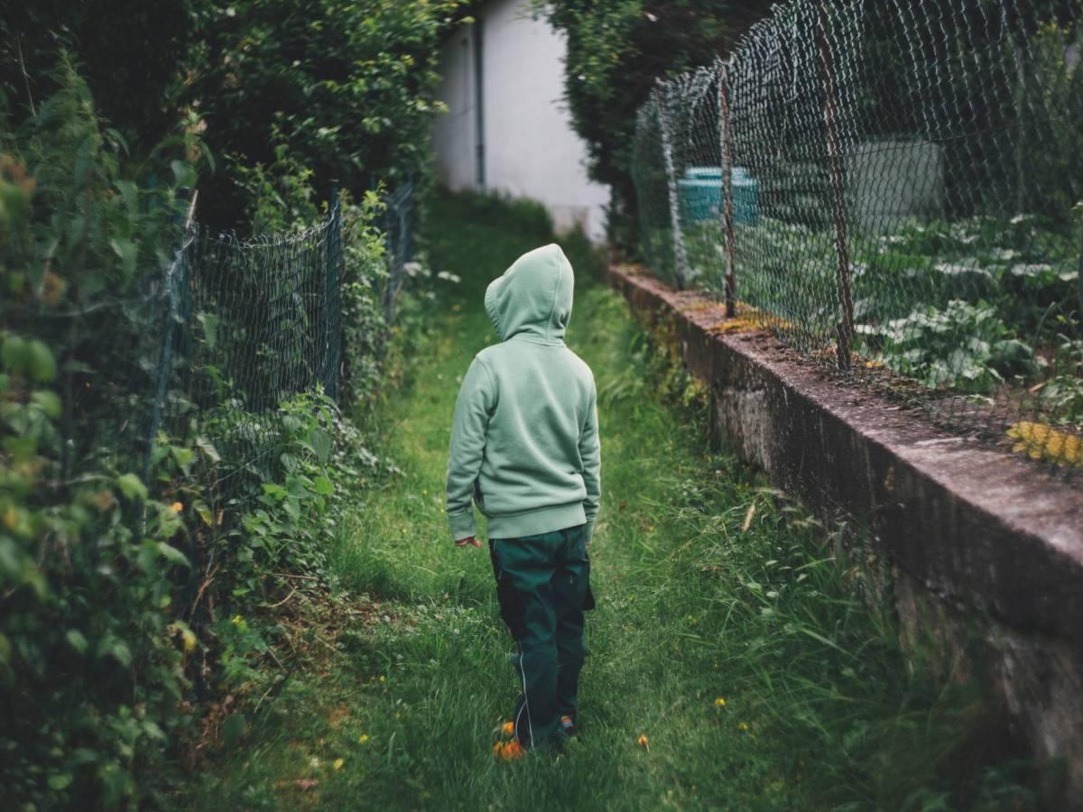Boy standing in the garden